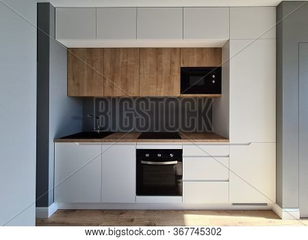 Installation Built-in Furniture And Wiring Kitchen. Upper Cabinets In Small Kitchens Are Made To Cei