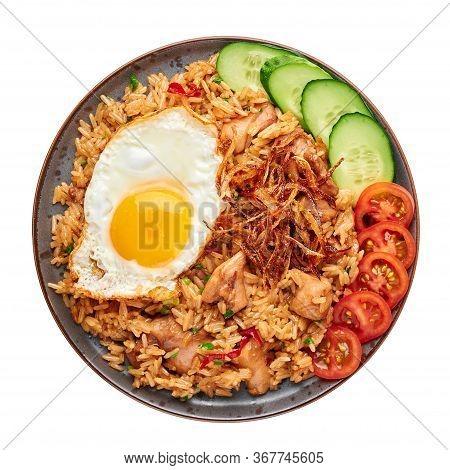 Nasi Goreng - Indonesian Chicken Fried Rice On Black Plate Isolated On White Backdrop. Nasi Goreng I