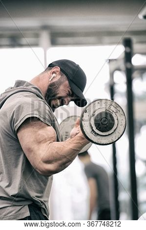 Sport Motivation Concept Of Strong Young Athlete Man With Beard Lifting Weight Barbell Pumping Iron