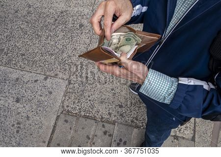 Looking Down At A Man With Open Wallet Ready To Spend Some Us Cash Currency Money Twenty Dollar Bill