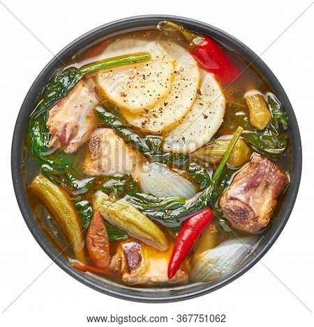 Sinigang Na Baboy Or Filipino Pork Meat Soup In Black Bowl Isolated On White Backdrop. Sinigang Is A