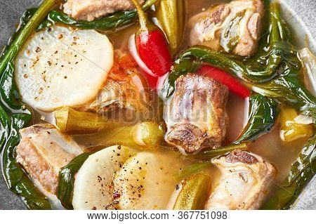 Sinigang Na Baboy Or Filipino Pork Meat Soup Close Up. Sinigang Is A Filipino Cuisine Dish With Meat