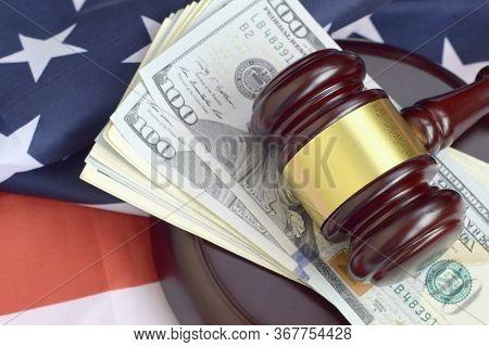 Judge Gavel And Money On United States Of America Flag. Many Hundred Dollar Bills Under Judge Malice