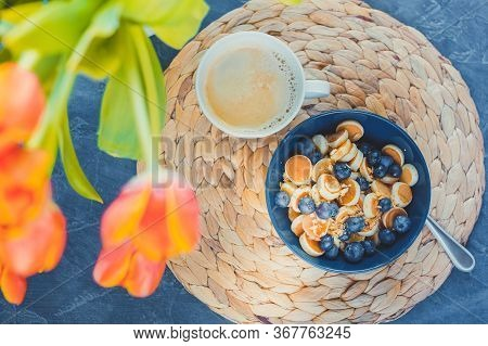 Toned Photo. Morning, Breakfast Time, Cereal Mini Pancake, Mini Pancakes In A Dark Blue Bowl With Ma