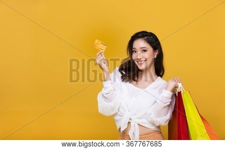 Portrait Asian Beautiful Happy Young Woman Smiling Cheerful And She Is Holding Credit Card And Using