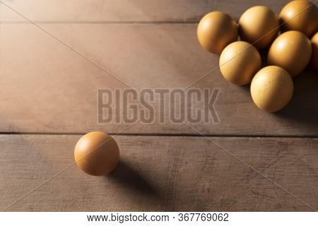 Social Distancing Concept. Checken Eggs Have One Chicken Egg Is Far Away From The Group Of Chicken E