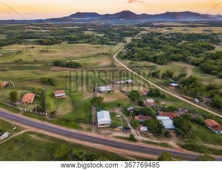 Aerial View Of Capii, A Village Between Villarrica, Mbocayaty And The Colonia Independencia With A V