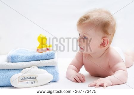 Cute Baby With Bath Accessories, Towels, Washcloth And Toys On White Background