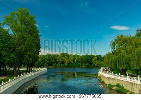 Summer Day Time Park Landscape Scenic View Of River Bay Waterfront District With Marble White Fence