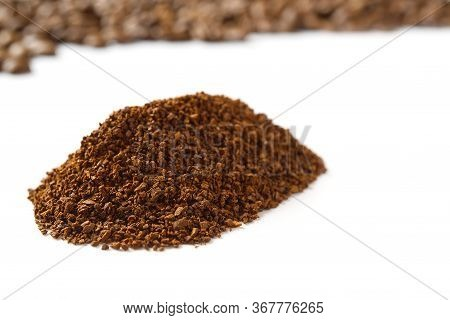 Pile Of The Ground Coffee Flakes Isolated Over The White Background. Pile Of Melted Coffee