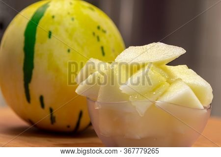 Yellow Melon In Pieces Served In A Bowl And In The Background The Whole Fruit