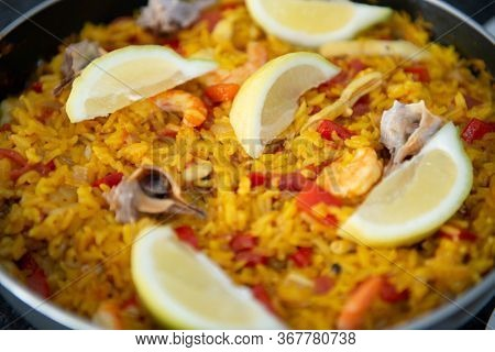 Seafood paella, traditional spanish food. Pan full of rice cooked with vegetables, shellfishs and shrimps
