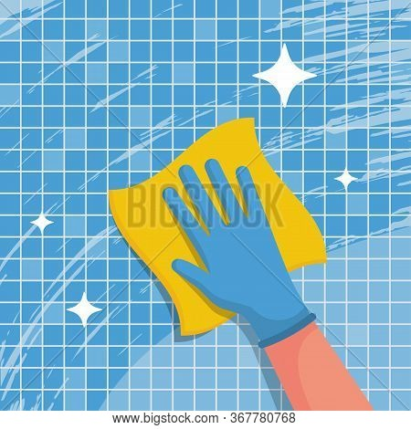 A Housework Worker Wipes The Tiles In The Bathroom With Napkin. Wipe With Cloth. Blue Gloves On The