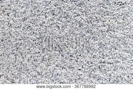 Gray Carpet With A Long And Soft Pile. Background With Carpet Pile.