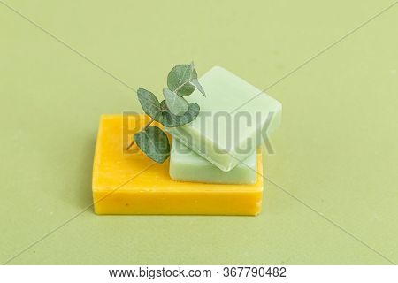 Sprig Of Eucalyptus And Natural Soap On A Green Background. Minimalism. Natural Elements
