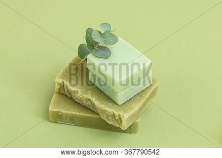 Sprig Of Eucalyptus And Natural Soap On A Green Background. Minimalism. Selective Focus. Green Monoc