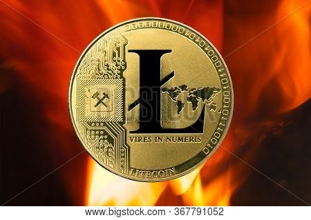 Physical Litecoin Gold Coin (ltc) With Fire Or Flame Background. Cryptocurrency Bull Market Growth W