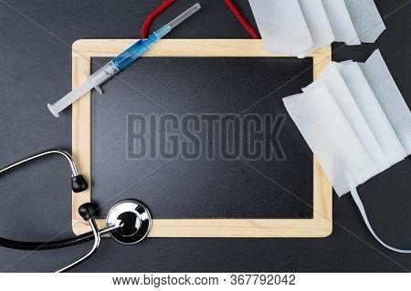 Blank Blackboard With Stethoscope, Syringe With Vaccine And Cut Protective Face Mask. End Of Quarant