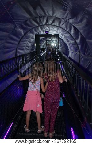 Museum Of Illusion, Wien - Aug 2019: A Little Girl Walks Along The Warp Hole. Hires.