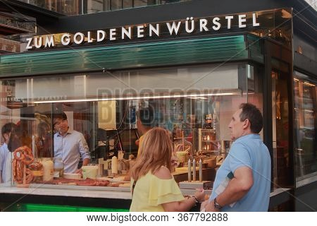 Wien - Aug 2019: Typical Viennese Street Food: Bretzel, Wurstel, Bratwurst, Rosti, Cake Sacker, Spat