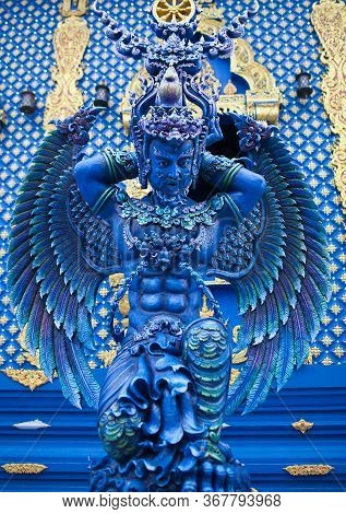 Blue Statue Of The Guard In Thai Lanna Style - Detail Of Exteror Of Wat Rong Suea Ten, Or Blue Templ