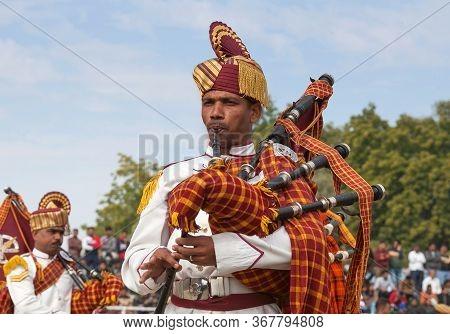 Bikaner, Rajasthan, India - January 11, 2020: Indian Military Bagpipers Band Playing Bagpipe During