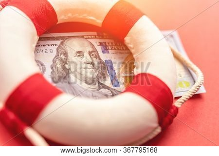 Lifebelt On Us Dollar Paper Banknote Bill Background. Global Economic Crisis Of 2020 Concept. Concep