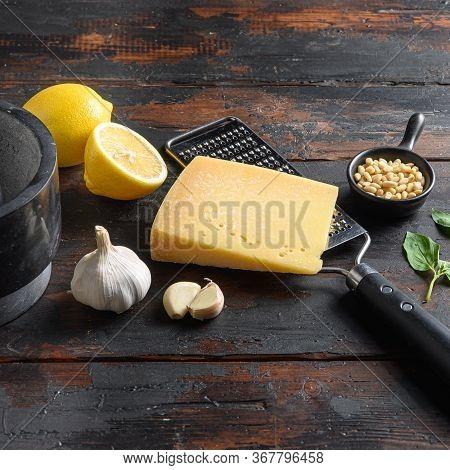 Square Parmesan Cheese, Basil Leaves, Pine Nuts, Garlic, And Mortar. Layout. Green Basil Pesto Alla