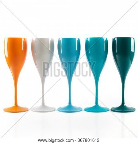 Five mulricolored champagne glasses  for gourmets. Isolated glass cup on wite background for festive events