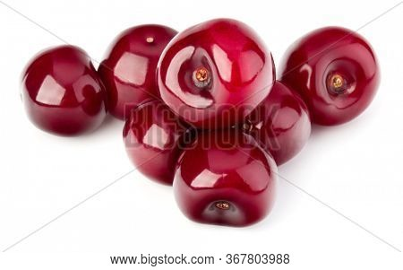 Sweet cherries pile isolated on white background