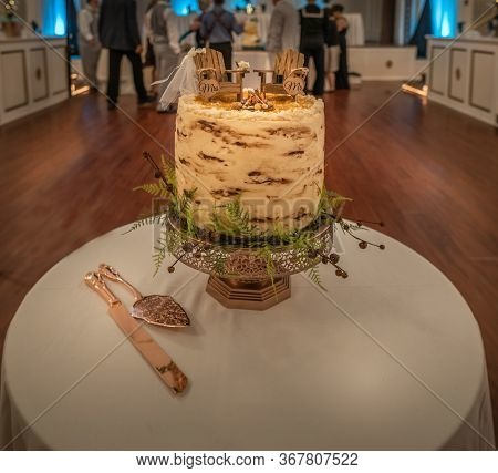 Rustic Style Wedding Cake Themed Around Camping With Adirondack Chairs Cake Topper On A Bark-style T