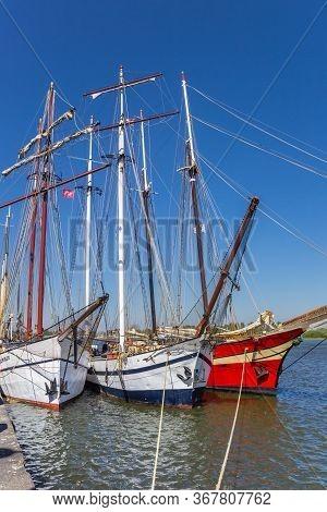 Kampen, Netherlands - April 22, 2020: Historic Tall Ships On The Ijssel River In Kampen, Netherlands