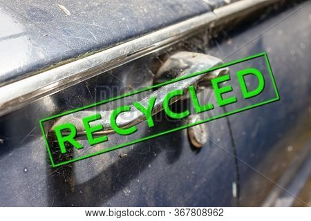 A Stamp Sign Recycled On A Part Of An Old Rusty Abandoned Car, Vehicle, Environmental Protection And