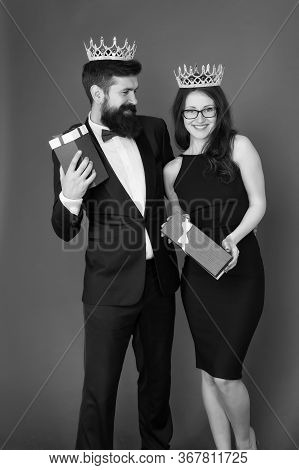 Beautiful People Celebrate Success. Couple In Love Wear Crowns Red Background. Enjoying Success. Gif