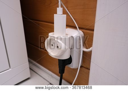 Overloaded Outlet With An Extension And Many Sockets Plugged In And One Vacant Place, Risk Of Fire A