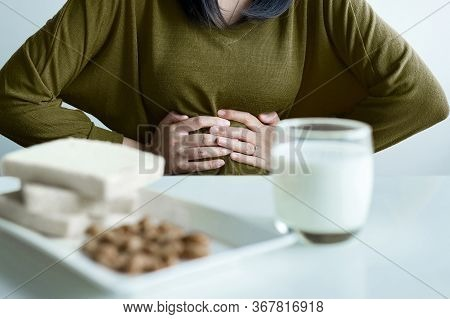 Allergy Dairy Intolerant,lactose Intolerance Concept,asian Woman Having A Stomach Pain With A Glass