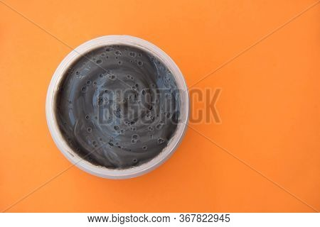 Cream Face Mask Gray Orange Background Top View, Skin Care