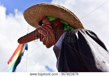 Cusco, Cusco, Peru - June 10, 2017: Peruvian Man Wearing A Large Nose Mask During A Religious Celebr