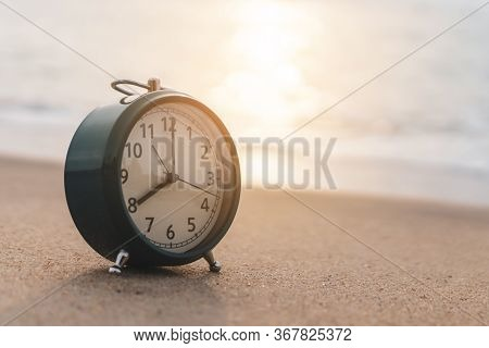 Selective Focus Of Alarm Clock On Side Table Beside Bed Show 8 O\'clock In The Morning Background.ti