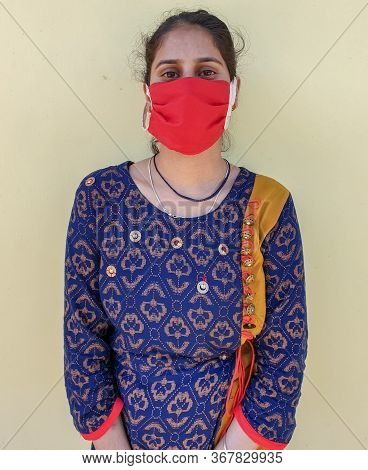 Photo Of A Young Indian Girl Wearing Face Mask For Prevention From Coronavirus During Lockdown With