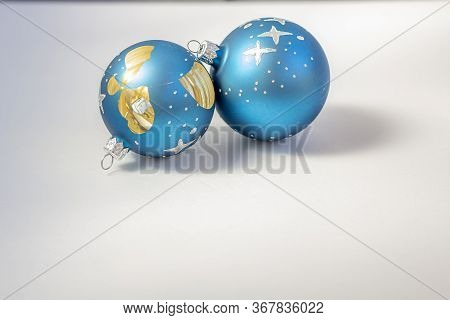 Two Broken Blue Christmas Balls On White Background As A Symbol Of Shattered Hopes, Loss, Disappoint
