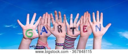 Children Hands Building Word Garten Means Garden, Blue Sky