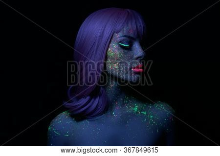 Fashion Model Woman In Neon Light Bright Fluorescent Makeup, Long Hair, Drop On Face. Beautiful Mode