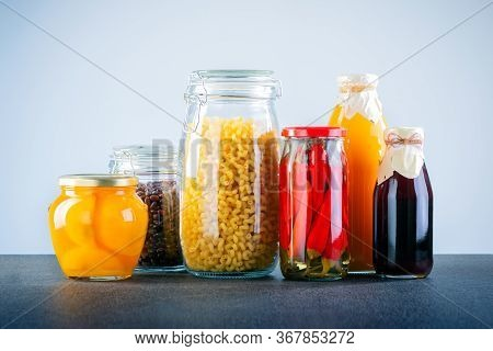 Glass Jars With Different Types Of Groat, Pasta, Vegetable And Juice. Different Donation Food. Diffe