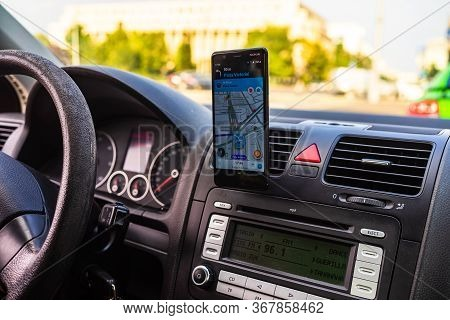 In Car Dashboard View With Smartphone Showing Police On Waze Maps. Driver Using Waze Maps In Buchare