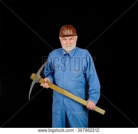 Man Holding Pick-axe. Male Miner Worker In Coveralls With Pickaxe. Construction And Building Works.