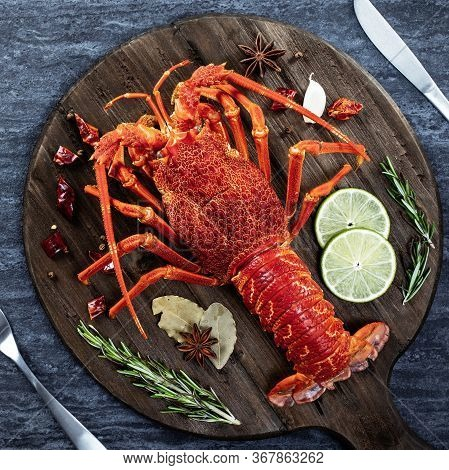 Cooked Boiled Lobster, Delicious Dinner Seafood Meal Set With Knife And Fork On Black Stone Slate Ba