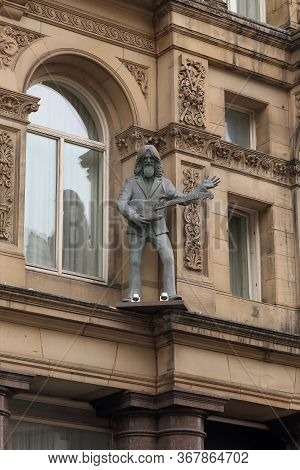 Liverpool, Great Britain - September 13, 2014: This Is A Sculpture Of George Harrison On The Eaves O