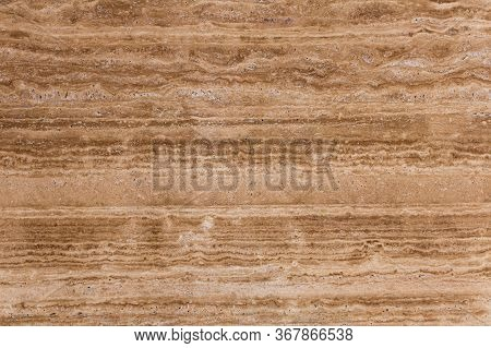Beige, Brown Natural Travertine Stone Texture Close-up.