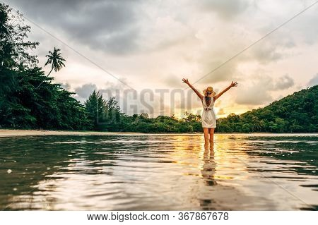 Young Happy Woman Rising Hands Up Enjoying Beautiful Sunset On The Sea